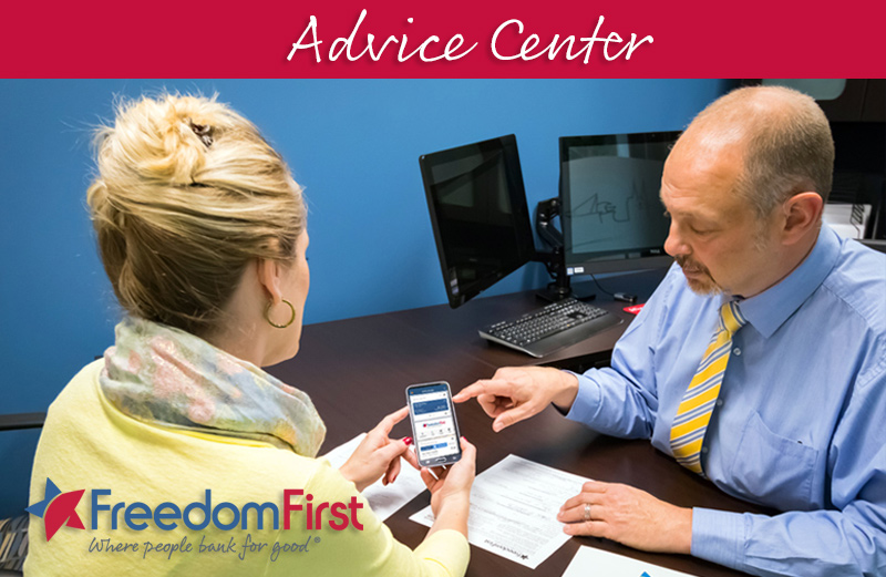 Man showing woman how to use Freedom First mobile app with header banner that says Advice Center