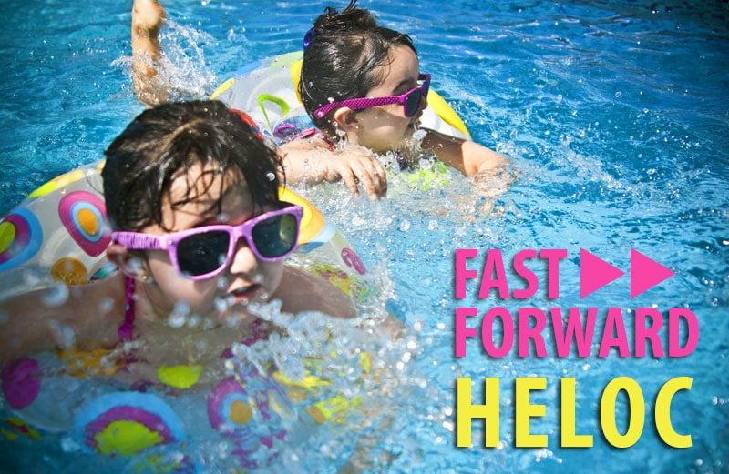 Two young girls in sunglasses swimming in inner tubes in a pool. Text: Fast Forward HELOC.