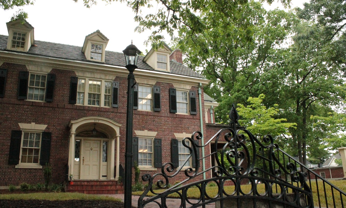 A brick Colonial house and wrought iron fence in the Old Southwest neighborhood in Roanoke.