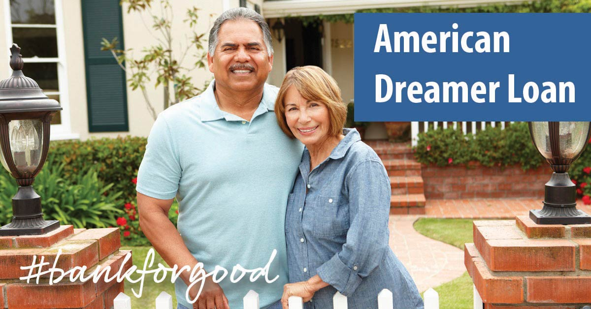 Smiling middle-aged couple standing in front of their home, caption: American Dreamer Loan, #bankforgood