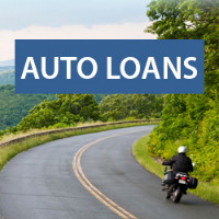 Text: Auto Loans; Background: Motorcycle driving on Blue Ridge Parkway