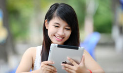 Smiling woman looking at tablet