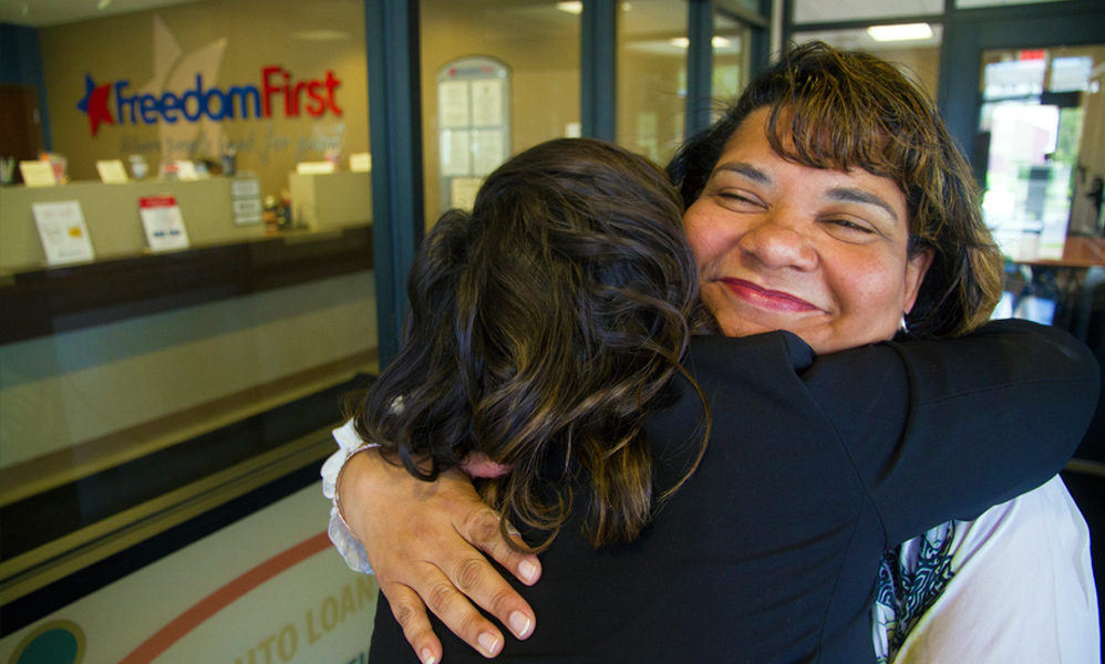 Two women embracing at the Freedom First West End branch.