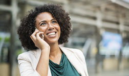 Smiling woman talking on cell phone