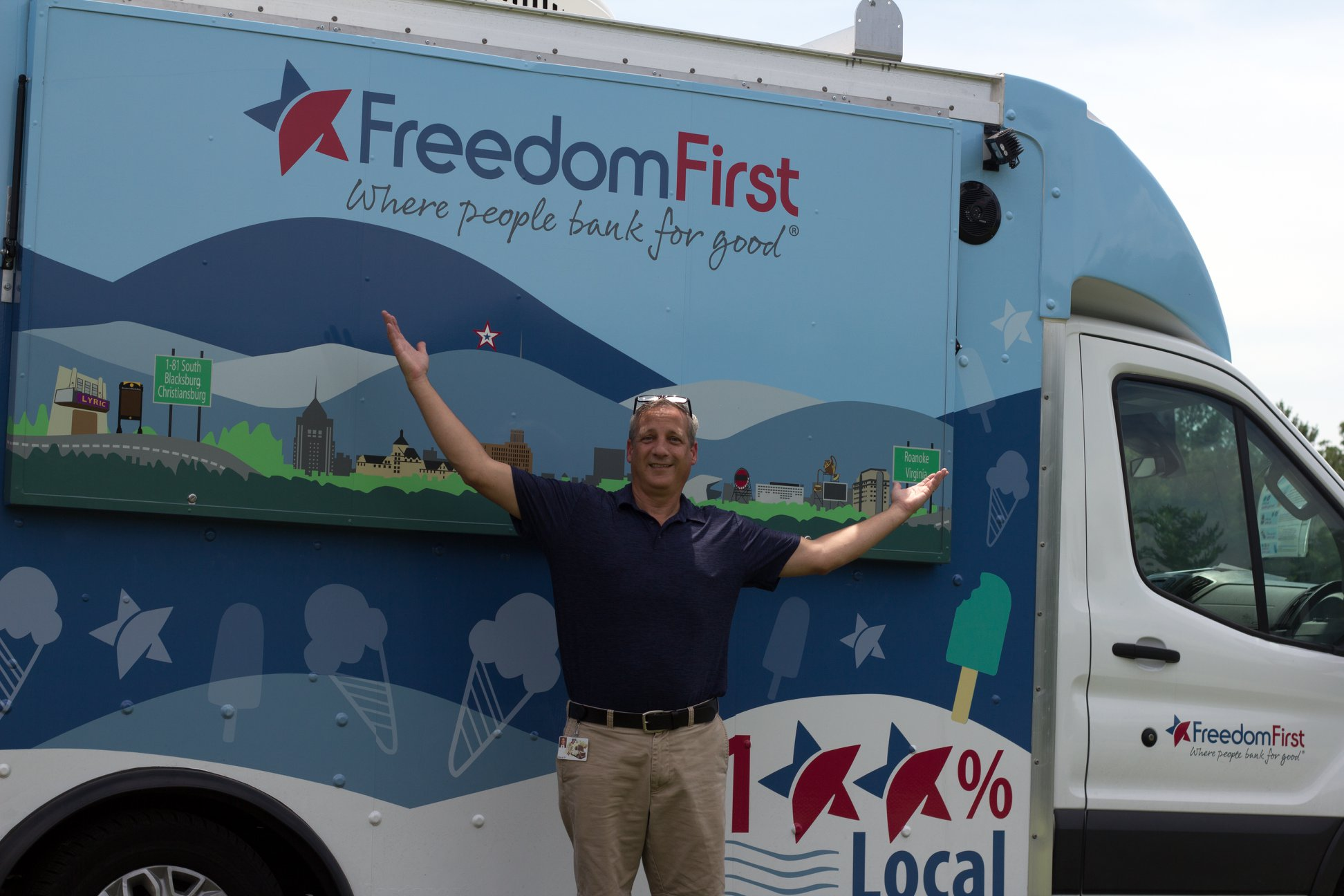 Dave Prosser standing in front of the Freedom First Scoop ice cream truck